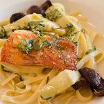 Salmon over Fettuccine with Capers, Artichokes, and Peas