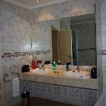 Bathroom is massive, 2 showers, bath, 2 sinks,