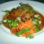 Duck Leg Confit - Confit duck leg served with mixed leaves & cucumber ribbons, soya honey & sesa