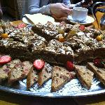 Platter of coffee and walnut cake and fruit cake