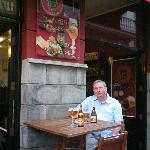 Quaffing Chouffre outside Maison Belge