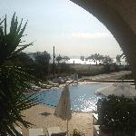 View from our bedroom of the pool and beach