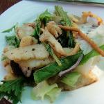 First course: Wok-seared calamari over Sonoma greens, plated