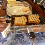 The old fashioned toaster with the homemade bread!