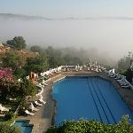 Pool surrounded by morning mist