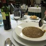look behind the wine glass to see the pot this lentil soup was served in.
