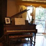 Baby grand piano.