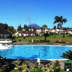 Breakfast by poolside with Mt Sinabung view ...
