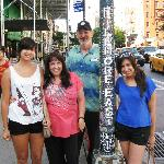 Family with Bob at the Fillmore East street light pole.