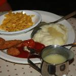 Chicken nuggets, mashed potatoes and gravy, and brown butter noodles