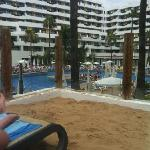 view of hotel from sun bed on sanded area