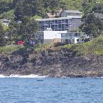 "View of our ""home"" from out on the water! It is the small yellow house on the right."
