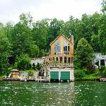 lake lure house with man-made waterfall (next to boat house)