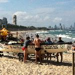 Burleigh Beach seems the best to me - safe for kids and close to great cafes and galleries