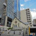 Old church swallowed up by modern buildings