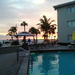 view of the beach from the pool at sunset