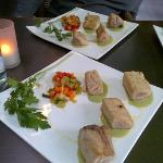 Tuna fish cubes in bread crust served with basil emulsion and crispy vegetables with fresh ginge