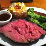 Prime Rib with Broccoli and Loaded Baked Potato.
