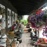 Lovely flowers and other goods on the porch