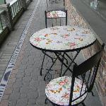 Two bistro tables at the front