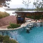 Club pool, swim-up bar and TV