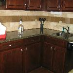 Nice Kitchenette with ss refridgerator, coffee pot, dishes, pots/pans