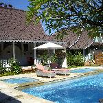 one of the cottages and pool