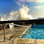 Ocean crashing into the pool