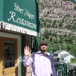 Our waiter, Brian, outside the Silver Nugget Cafe. Note the San Juan Mountains in the background