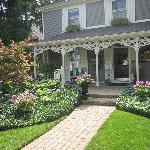Lovely frontage with verandah and rocking chairs.