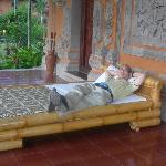 bed outside door and balinese door