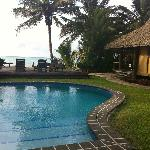Bach front bungalow next to beach and pool.