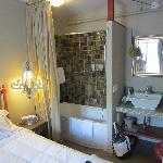 bathroom in same room as bedroom