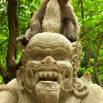 Monkey sitting on statue