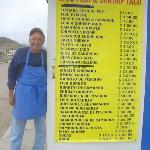 Tacho standing next to his menu