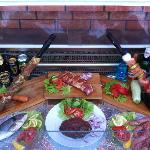 Some of our dishes on display outside pork skewer, pork ribs, chicken skewer, sea bass, sirloin