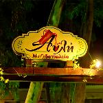Avli Corfu the yard at night sign