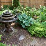 Fountain in corner of back yard