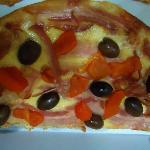 Pizza , muy rica .