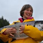 Guest with BIG Chinook salmon caught near resort