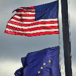 Alaska & U.S. Flags fly over Waterfall Resort's dock