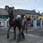 statue in the Market Place for the Ballinasloe Annual Horse Fair, An Tain in the background