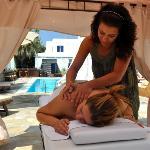 massaze next to the pool