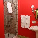 """Red"" room bathroom and shower"