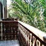 some rooms have a private balcony overlooking the garden