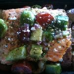 Salmon with tomatoes, cucumber and potatoes - served hot!