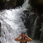 Enjoying one of the waterfalls on property