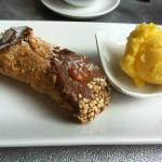 Cannolo with ricotta and fig filling and mandarin sorbet