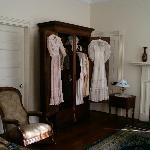Some of Helen's and Mrs. Keller's clothing displayed in Capt. & Mrs. Keller's bedroom