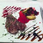 A steak with berries and apple